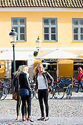 Young women visitors in old town square in Malmo, Sweden