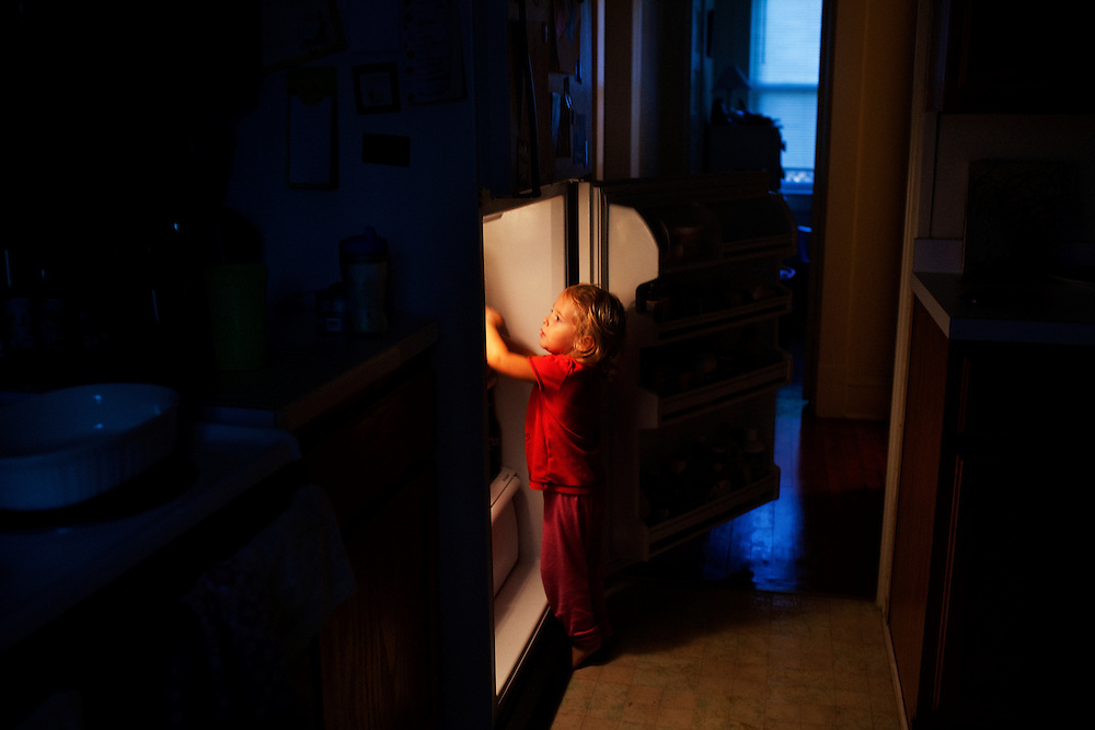 Madelyn Avery Eich, 2, opens the fridge as she attempts to gather the supplies necessary for her favorite drink, chocolate milk, in Norfolk, Virginia on Monday, September 20, 2010.