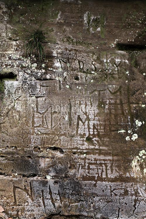 old carved lettering on rock