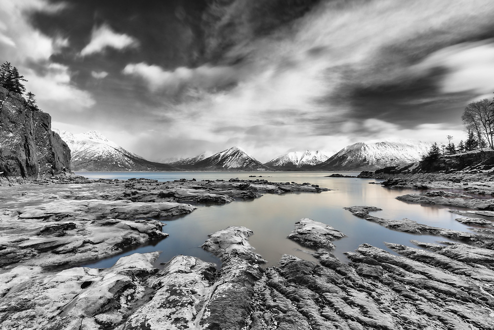 Low tide reveals sculpted silt along Turnagain Arm near Hope in Southcentral Alaska. Winter. Afternoon.