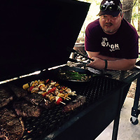 ALICE ORTIZ/BUY AT PHOTOS.MONROECOUNTYJOURNAL.COM<br /> Monroe County Veterans Service Officer Jason Sullivan stands beside his grill, which is full of any array of food.