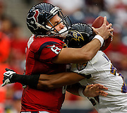 Oct 21, 2012; Houston, TX, USA; Baltimore Ravens cornerback Cary Williams (29) sacks Houston Texans quarterback Matt Schaub (8) during the second half at Reliant Stadium. Mandatory Credit: Thomas Campbell-www.thomasgcampbell.com