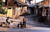 Local resident pumps water from the communal water pump in this small village.