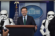 R2D2 and Storm Troopers of Star Wars makes a surprise appearance with Josh Earnest at the White House on Friday 18th December,very shortly after President Obama final year Press Conference