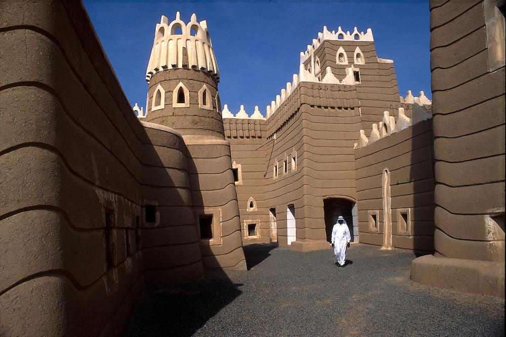 SAUDI ARABIA:Najran. A guide inside the adobe Palace of Ibn Madi