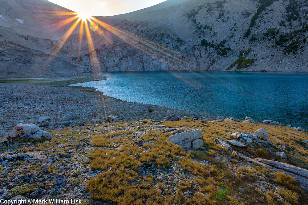 Sun burst above Cirque Lake, White Cloud Wilderness.