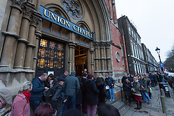 "© Licensed to London News Pictures. 17/01/2016. London, UK. Bowie fans queue for a public tribute event called ""Starman: A celebration of David Bowie"" at the Union Chapel in Highbury and Islington. The gig pays tribute and celebrates the life of David Bowie who died on 10 January 2016. Photo credit : Vickie Flores/LNP"