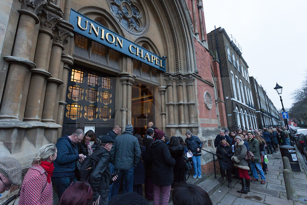 """© Licensed to London News Pictures. 17/01/2016. London, UK. Bowie fans queue for a public tribute event called """"Starman: A celebration of David Bowie"""" at the Union Chapel in Highbury and Islington. The gig pays tribute and celebrates the life of David Bowie who died on 10 January 2016. Photo credit : Vickie Flores/LNP"""