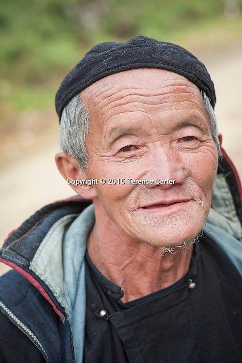 A hilltribe man makes his way home to his village after visiting the markets of Sapa, Vietnam.