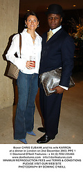 Boxer CHRIS EUBANK and his wife KARRON at a dinner in London on 2nd December 2003.PPE 1