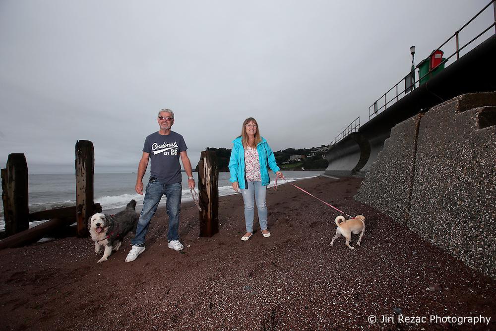 UK ENGLAND DEVON TEIGNMOUTH 10SEP16 - Retiree Ray Jones (67) and his wife Sue Jones (56), a social worker, of Bridgewater walk their dogs Millie (8) and Bella (3) at Teignmouth beach, Devon, England.<br /> <br /> jre/Photo by Jiri Rezac<br /> <br /> © Jiri Rezac 2016