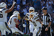 Sep 8, 2019; Carson, CA, USA; Los Angeles Chargers running back Austin Ekeler (30) celebrates with tight end Hunter Henry (86), fullback Derek Watt (34) and tight end Virgil Green (88) after scoring on a 7-yard touchdown run in overtime against the Indianapolis Colts at Dignity Health Sports Park. The Chargers defeated the Colts 30-24 in overtime.