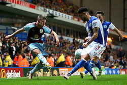 Johann Gudmundsson of Burnley crosses under pressure from Derrick Williams of Blackburn Rovers - Mandatory by-line: Matt McNulty/JMP - 23/08/2017 - FOOTBALL - Ewood Park - Blackburn, England - Blackburn Rovers v Burnley - Carabao Cup - Second Round