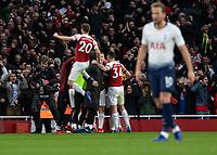 Football - 2018 / 2019 Premier League - Arsenal vs. Tottenham Hotspur<br /> <br /> Shkodran Mustafi (Arsenal FC) leaps into the air as his team mates congratulate Pierre-Emerick Aubameyang (Arsenal FC) after scoring the equaliser at The Emirates.<br /> <br /> COLORSPORT/DANIEL BEARHAM