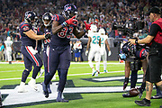 Houston Texans rookie tight end Jordan Thomas (83) hams it up for a field level cameraman as he celebrates after catching a third quarter touchdown pass for a 21-10 Texans lead during the NFL week 8 regular season football game against the Miami Dolphins on Thursday, Oct. 25, 2018 in Houston. The Texans won the game 42-23. (©Paul Anthony Spinelli)