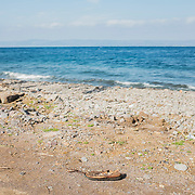 A refugee shoe left on the beach of Lesbos, right in front of Turkey