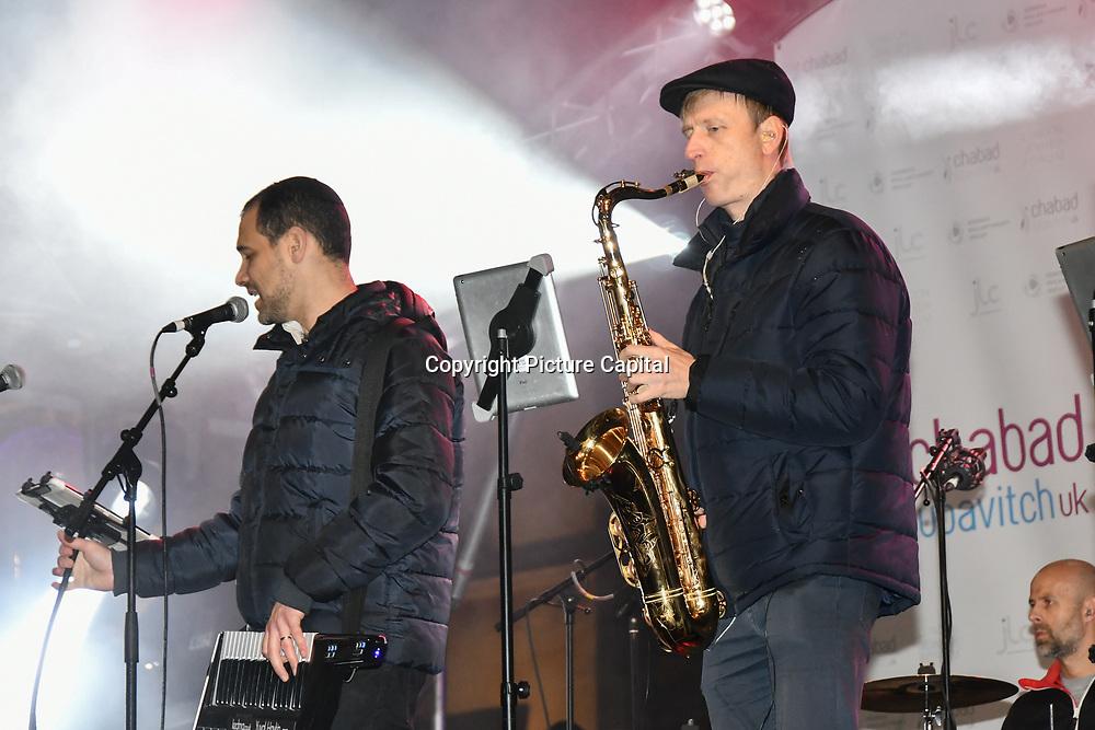 Rabbi Mark Levine  and Klezmer band preforms at the ceremony to light a sacred Menorah to celebrate Chanukah (Hanukkah), the eight-day Jewish Festival in Trafalgar Square, 5th December 2018, London, UK.