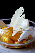 Tropical fruit vacherin with citrus and vanilla sorbets at The Mansion Restaurant at Rosewood Mansion on Turtle Creek in Dallas, TX.