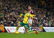 Norwich City's Jamal Lewis and Sheffield United's George Baldock during the EFL Sky Bet Championship match between Norwich City and Sheffield Utd at Carrow Road, Norwich, England on 20 January 2018. Photo by John Marsh.