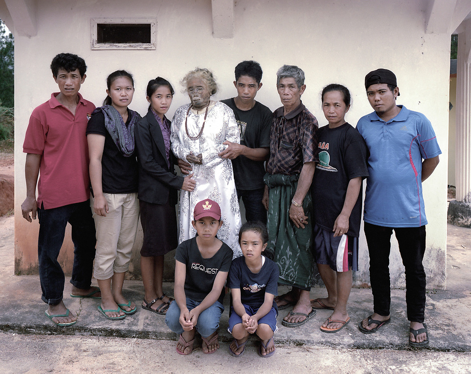 Martha Limbong, who passed away in 2015 at age 72, and her family<br /> <br /> Ma'nene is a tradition that takes place in August after harvest where the bodies of the dead loved ones are exhumed to be cleaned, groomed and dressed. For most, it's a bittersweet moment, a chance to reunite and physically see and touch and reconnect with loved ones who had passed on.
