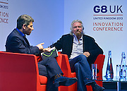 © Licensed to London News Pictures. 14/06/2013. London, UK Richard Branson (right) talks to David Rowan, editor of Wired magazine. attends G8 Innovation Conference at the Siemens Crystal Building in London today 14th June 2013. As part of UK's G8 Presidency, the G8 Innovation Conference brings together 300 leading international entrepreneurs, researchers, scientists, designers and policy makers. Photo credit : Stephen Simpson/LNP