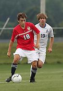 May 12, 2012; Huntsville, AL, USA;  Oak Mountain's Tyler Aderholt (18) controls the ball from \Auburn's Alec Rhodes (19). Mandatory Credit: Marvin Gentry