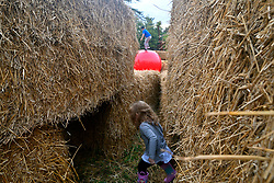 Families enjoy a straw maze at the Woodmere Art Museum in Philadelphia, PA, on September 13, 2019. Temporary installation is designed by by architects Peter Everett Brown and Barbara Ann Sprague.