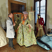 Francesco Briggi of Atelier Pietro Longhi dresses a customer with a 1700 Costume. Artisans, masks and costumes makers are getting ready ahead of Venice Carnival 2013