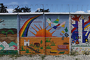 """Mural painted by different organizations and artists on the fence surrounding the Historic National Police Archives reads: """"From silence to hope."""". On July 5, 2005, the historical archives of the now dissolved National Police were found in an abandoned arms depot in the outskirts of Guatemala City. The discovery of these millions of documents, which were allegedly lost after the 1996 Peace Accords, provide important evidence in the search for the thousands of people who were detained and subsequently disappeared by State security forces during the internal armed conflict (1960-1996). Guatemala City, Guatemala. December 13, 2011."""