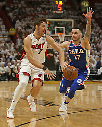 April 19, 2018 - Miami, Florida, U.S. - The Miami Heat's GORAN DRAGIC, left, passes against the Philadelphia 76ers' JJ REDICK during the first quarter in Game 3 of a first-round NBA playoff series at AmericanAirlines Arena in Miami. (Credit Image: © David Santiago/TNS via ZUMA Wire)