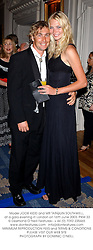 Model JODIE KIDD and MR TARQUIN SOUTHWELL, at a gala evening in London on 16th June 2003.PKM 33
