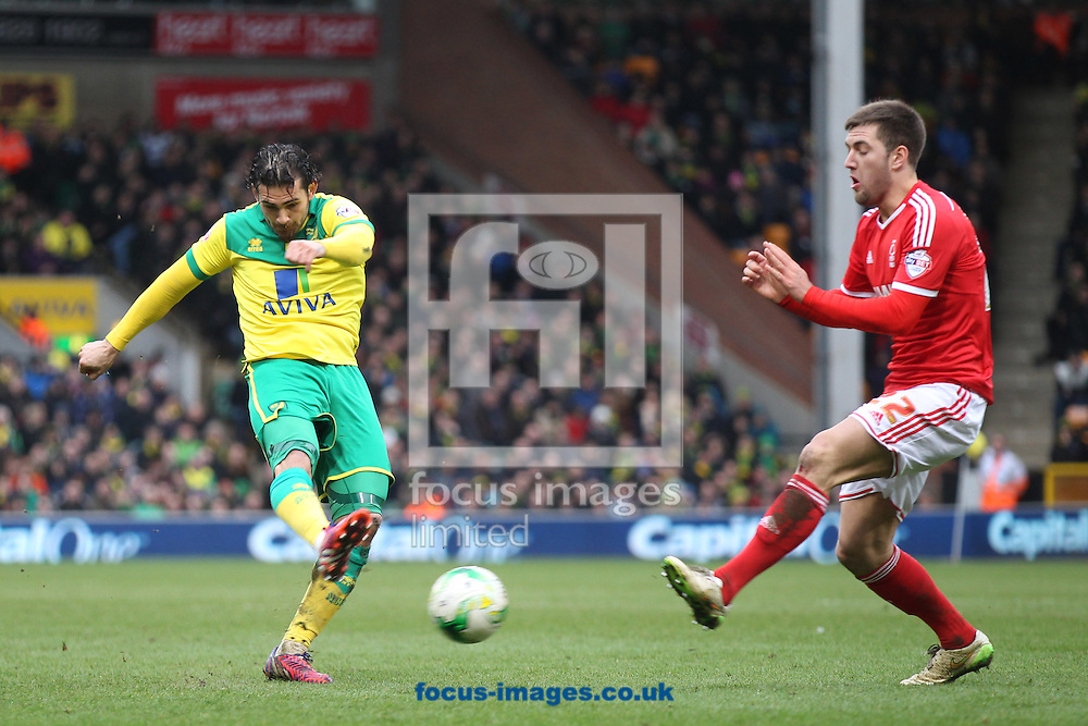 Bradley Johnson of Norwich has a shot on goal during the Sky Bet Championship match at Carrow Road, Norwich<br /> Picture by Paul Chesterton/Focus Images Ltd +44 7904 640267<br /> 21/03/2015