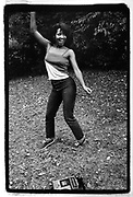Black female dancing in Central Park, New York City 1980