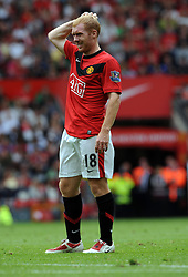 Paul Scholes of Manchester United itches his head during the Barclays Premier League match between Manchester United and Birmingham City at Old Trafford on August 16, 2009 in Manchester, England.