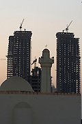 New skyscrapers and a mosque along the Western Corniche under construction.