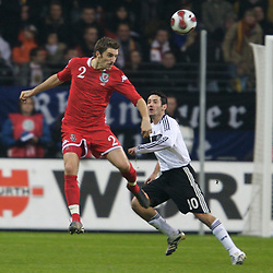 FRANKFURT, GERMANY - Wednesday, November 21, 2007: Wales' Sam Ricketts and Germany's Oliver Neuville during the final UEFA Euro 2008 Qualifying Group D match at the Commerzbank Arena. (Pic by David Rawcliffe/Propaganda)