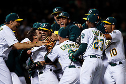 OAKLAND, CA - MAY 07: Mike Fiers #50 of the Oakland Athletics celebrates with teammates after pitching a no hitter against the Cincinnati Reds at the Oakland Coliseum on May 7, 2019 in Oakland, California. The Oakland Athletics defeated the Cincinnati Reds 2-0. (Photo by Jason O. Watson/Getty Images) *** Local Caption *** Mike Fiers