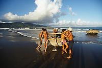 Fishermen with traditional basket boat on China Beach, Danang, Vietnam