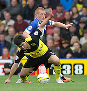 Picture by David Horn/Focus Images Ltd +44 7545 970036<br /> 28/09/2013<br /> Fernando Forestieri of Watford and James McClean of Wigan Athletic during the Sky Bet Championship match at Vicarage Road, Watford.