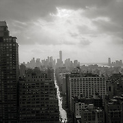 "Sunlight peaking thru the clouds over Manhattan over the World Trade Center Freedom Tower. Black and white image from the series ""Down with the Ship"""