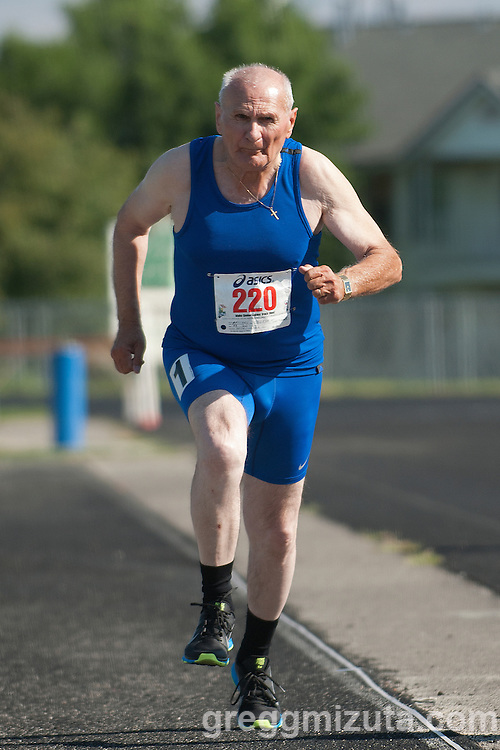 George Pescaru on the runway during the during the long jump event at the Idaho Senior Games at Timberline High School in Boise, Idaho on August 3, 2013. Pescaru finished first in the M70 Division with a jump of 9-02.00.