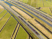 Nederland, Zuid-Holland, Gemeente Alkemade, 20-02-2012; infrastructuur bundel bestaande uit autosnelweg A4 en het hogesnelheidspoor HSL-Zuid (onder) doorkruist het veenweidelandschap tussen Roelofarendsveen en Rijpwetering. Op het spoor rijdt een Fyra..Infrastructure bundle consisting of A4 motorway and the high-speed (top) crosses the bog meadows area between Roelofarendsveen and crosses the Rijpwetering..luchtfoto (toeslag), aerial photo (additional fee required).copyright foto/photo Siebe Swart