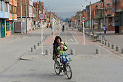 A woman commuting with child along the bikeway line in Patio Bonito - Bogota - Colombia