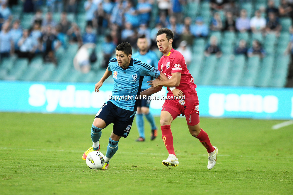 22.12.2011 Sydney, Australia. Adelaide midfielder Fabian Barbiero and Sydney forward  Dimitri Petratos fight for the ball during the A-League game between Sydney FC and Adelaide United played at the Sydney Football Stadium.