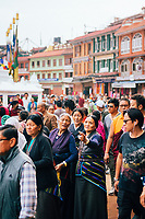 Crowds of people during their morning devotions at Boudhanath Temple in Kathmandu.