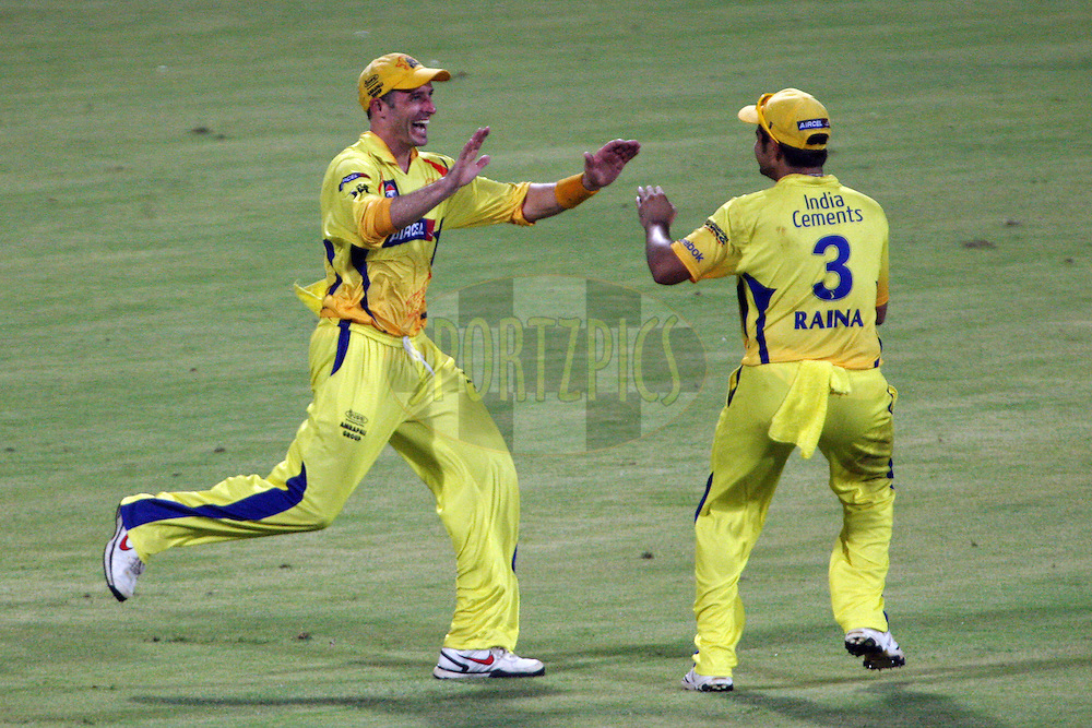 Michael Hussey and Suresh Raina celebrate a wicket during the final of the Indian Premier League ( IPL ) Season 4 between the Chennai Superkings and the Royal Challengers Bangalore held at the MA Chidambaram Stadium in Chennai, Tamil Nadu, India on the 28th April 2011..Photo by Jacques Rossouw/BCCI/SPORTZPICS