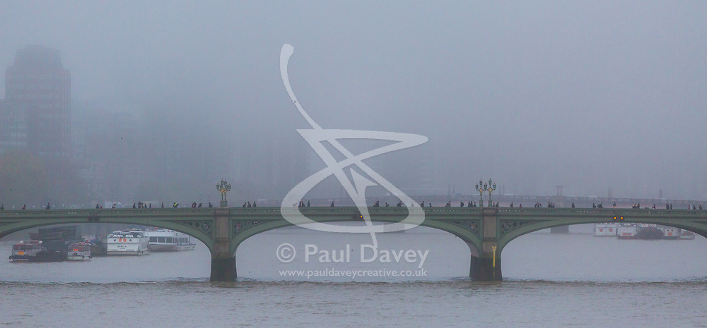 London, October 26 2017. Commuters make their way across Westminster Bridge as London wakes up to a cool, misty autumn morning. © Paul Davey