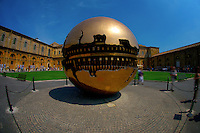 ROME, ITALY - JUNE 03: Illustration of Rome; Italy on June 03, 2012..The treasures of the Vatican. Sfera Con Sfera. Pomodoro..Sphere Within Sphere is a bronze sculpture, by Italian sculptor, Arnaldo Pomodoro.?Versions of the sculpture can be seen in the Vatican Museums and the Palazzo della Farnesina in Rome, Trinity College Dublin, the United Nations Headquarters in New York, the Hirshhorn Museum and Sculpture Garden in Washington D.C.,  Christian Theological Seminary in Indianapolis, the Columbus Museum of Art in Columbus, Ohio, the de Young Museum in San Francisco, Tehran Museum of Contemporary Art in Tehran,the Des Moines Art Center in Des Moines, the Hakone Open-Air Museum of Japan, the University of California, Berkeley and the Tel aviv University in Israel.?Pomodoro designed a controversial fiberglass crucifix for the Cathedral of St. John the Evangelist in Milwaukee, Wisconsin. The piece is topped with a fourteen foot in diameter crown of thorns which hovers over the figure of Christ.
