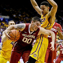 Jan 30, 2016; Baton Rouge, LA, USA; Oklahoma Sooners forward Ryan Spangler (00) drives past LSU Tigers forward Ben Simmons (25) during the second half of a game at the Pete Maravich Assembly Center. Oklahoma defeated LSU 77-75. Mandatory Credit: Derick E. Hingle-USA TODAY Sports