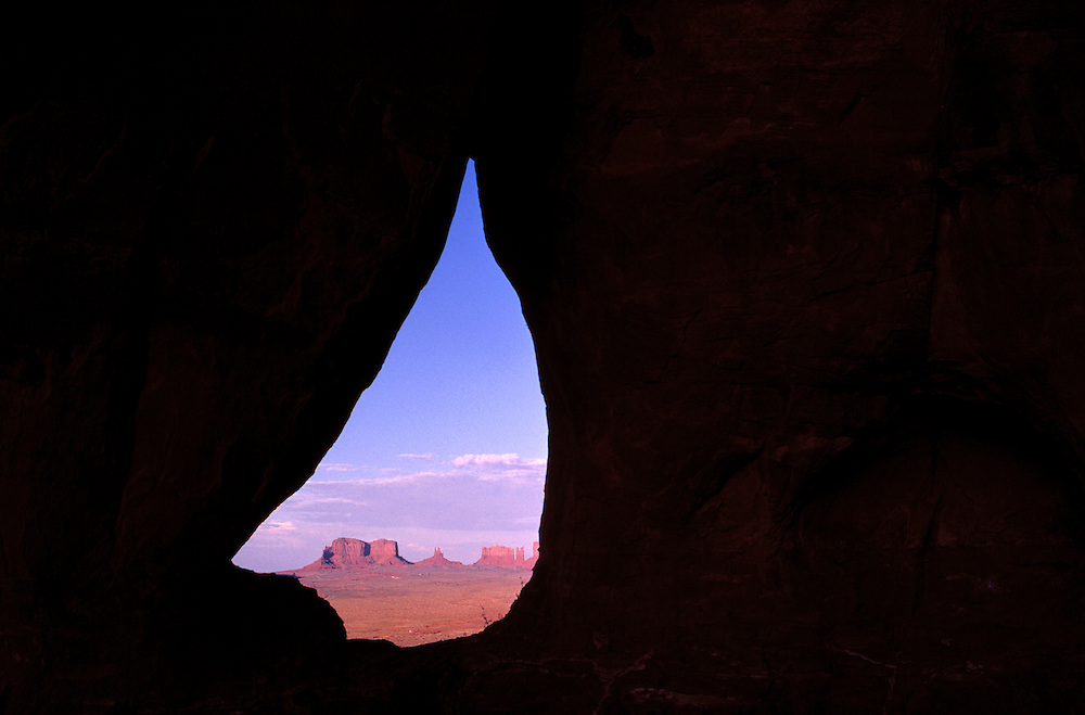 The buttes in Monument Valley, Utah, are easily seen through Keyhole Arch.